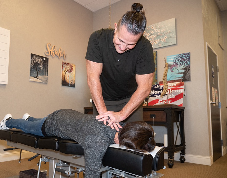 Dr. Joe adjusting patients back