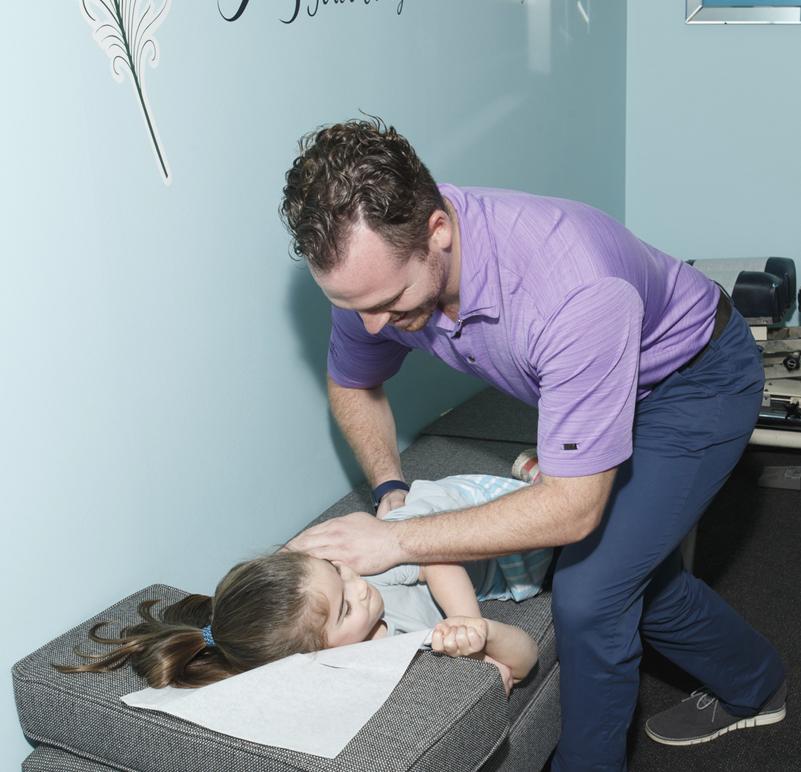 Dr Alec adjusting young girl