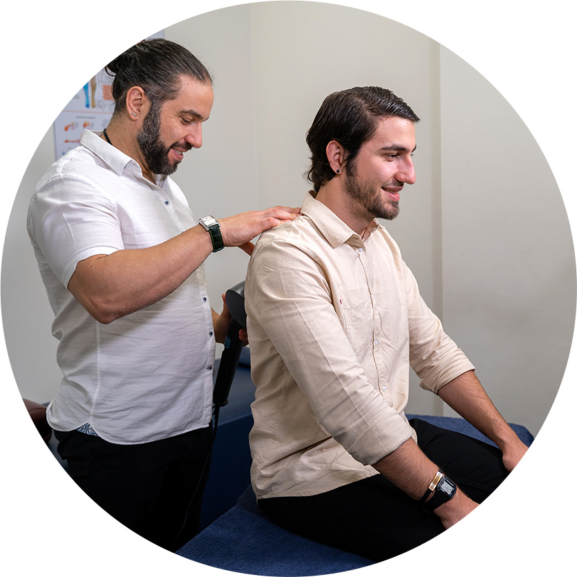 Dr. George using tool on mans back