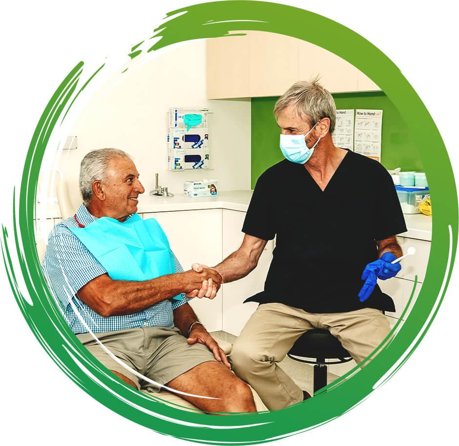 Dentist shaking patients hand