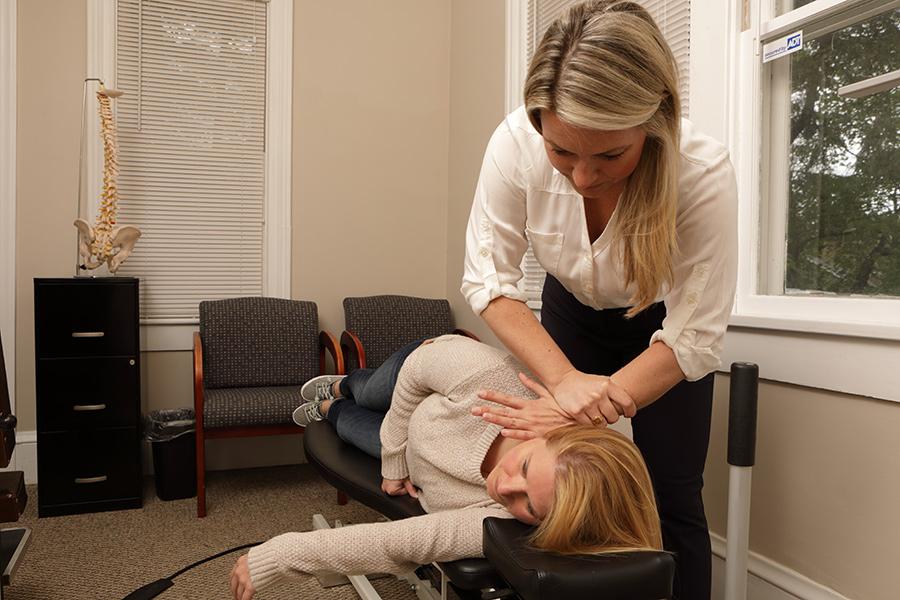 Hands adjusting patient