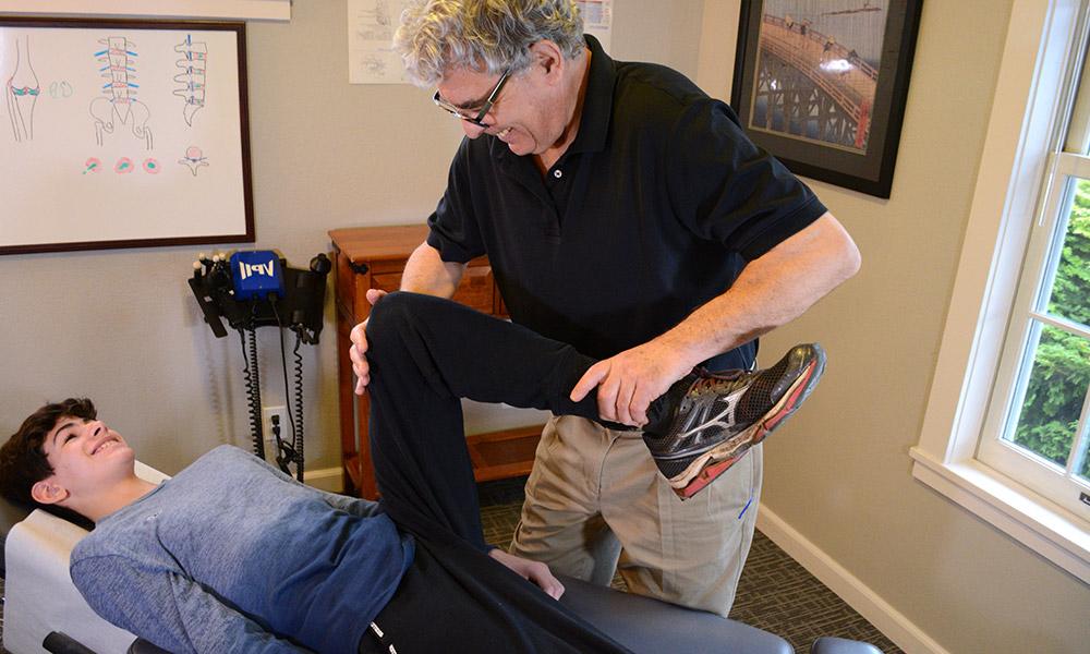 Dr. Keeler stretch patients leg