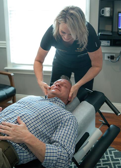 Dr Jenny adjusting patient's neck