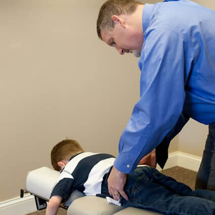 Dr RJ adjusting young boy