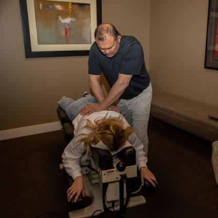 Dr. Ogata adjusting client