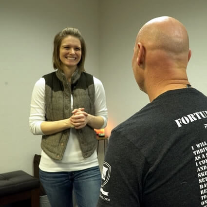 Dr. Nicole talking with practice member