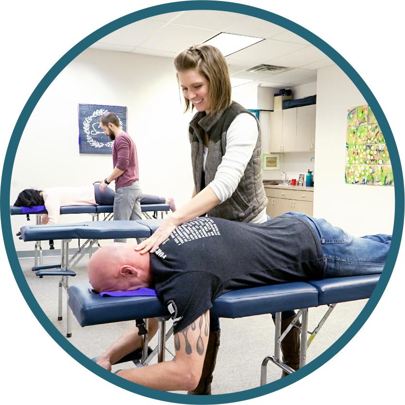 Dr. Nicole Evans and Dr. Jared Lane adjusting patients