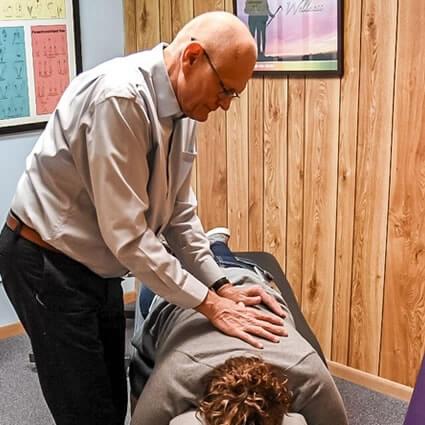 Dr. Terry adjusting patient