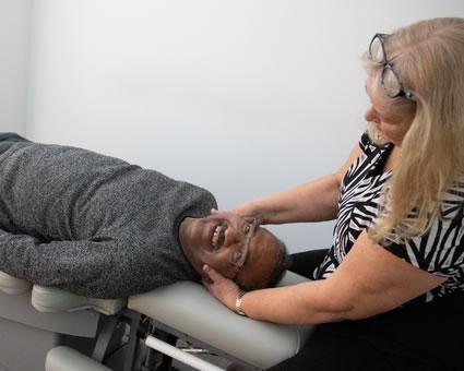 Dr Andersen adjusting mans neck