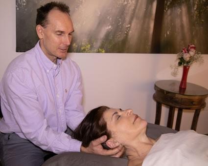 Jason massaging womans neck