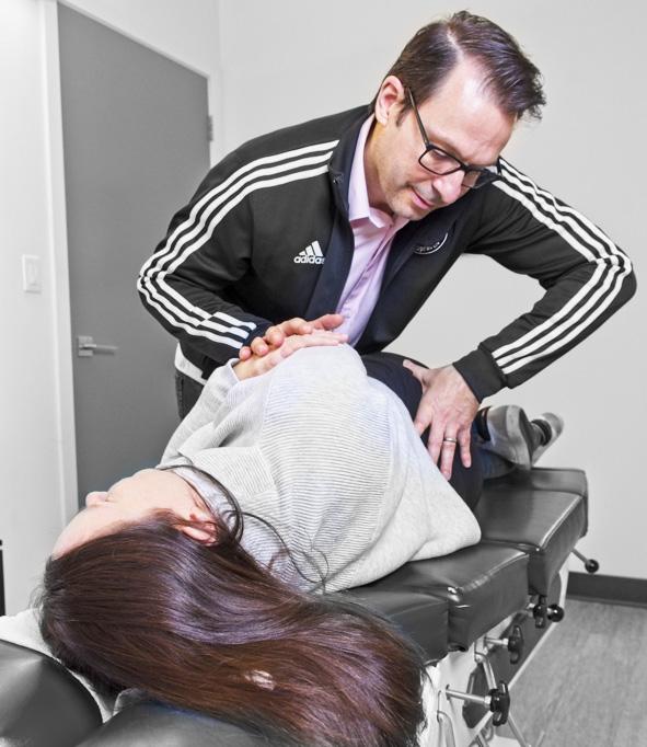 Dr. Barone adjusting practice member