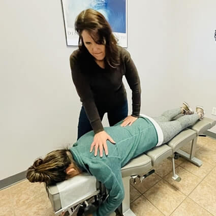 Woman getting back adjustment