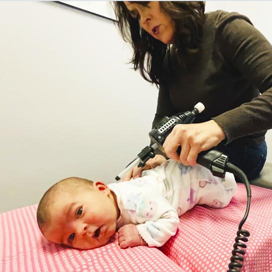 Dr. Beth adjusting infant