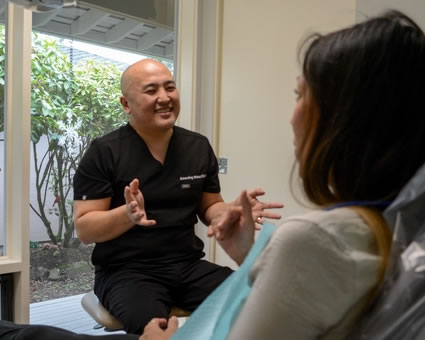 Female patient talking to dentist