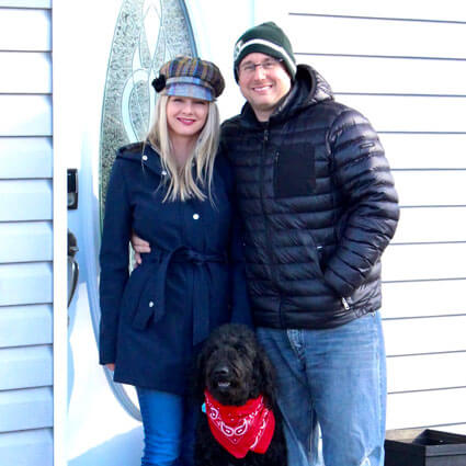 Dr. Faught with wife and dog