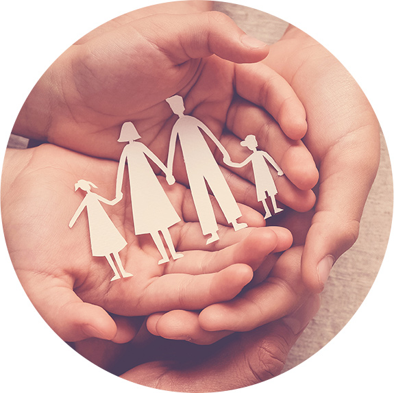 paper family cutout in hands