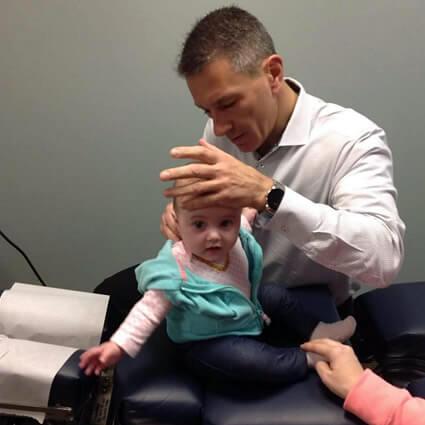 Dr. DiRubba adjusting baby