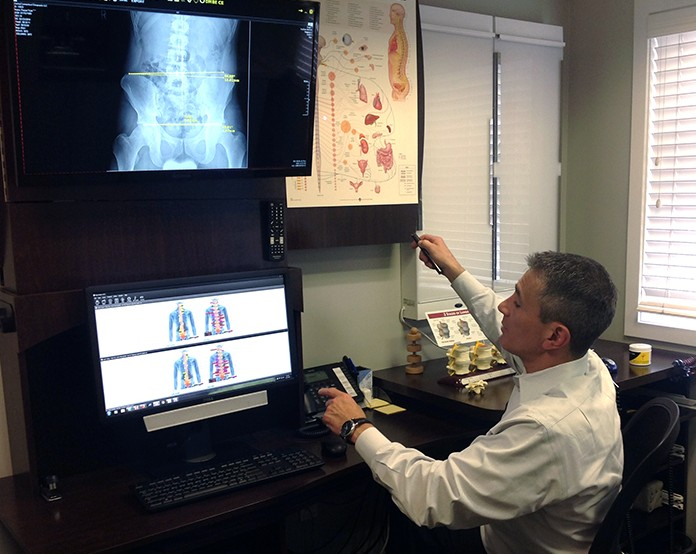 Doctor reviewing x-ray images