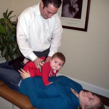 Dr Bret adjusting baby