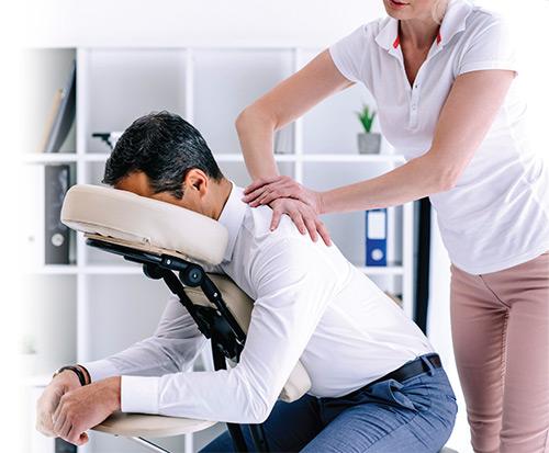 Man receiving a chair massage