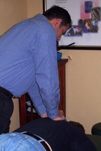 Tukwila chiropractor Dr. Virk with patient