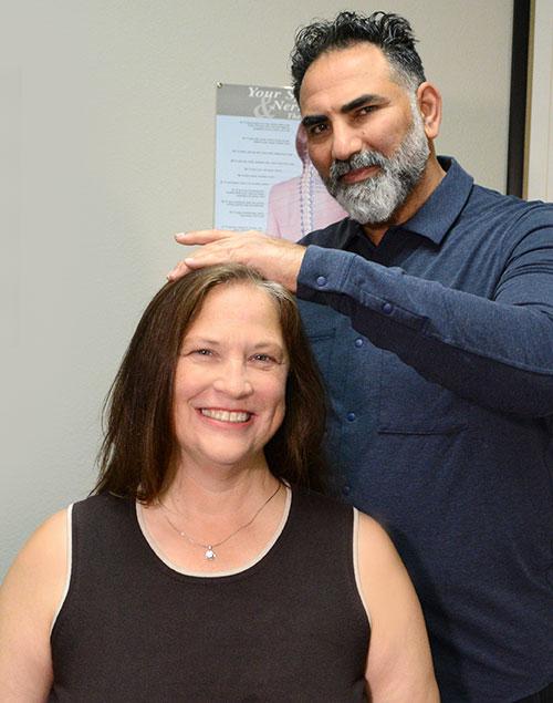 Dr. Kirk Adjusting patient