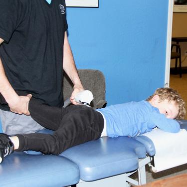 Dr. Alex adjusting patient