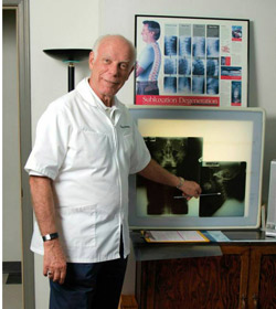Photo of Dr. Harrie Wolverton with xrays.