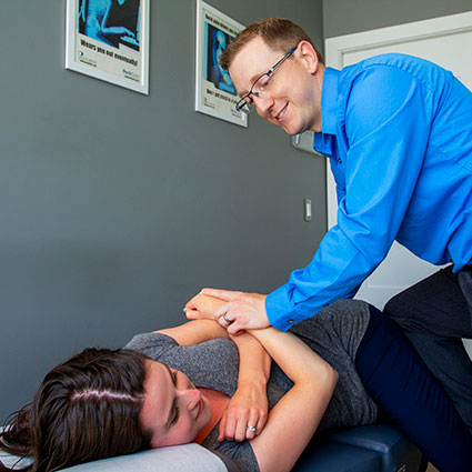 Dr Bateman adjusting patient