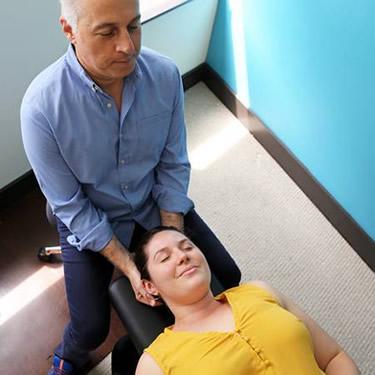 Dr. Diamond adjusting neck