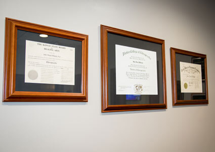 Dr. Wheeler's degrees on wall