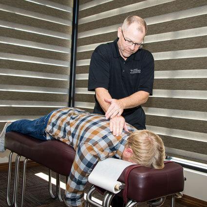 Chiropractic adjustment on upper back