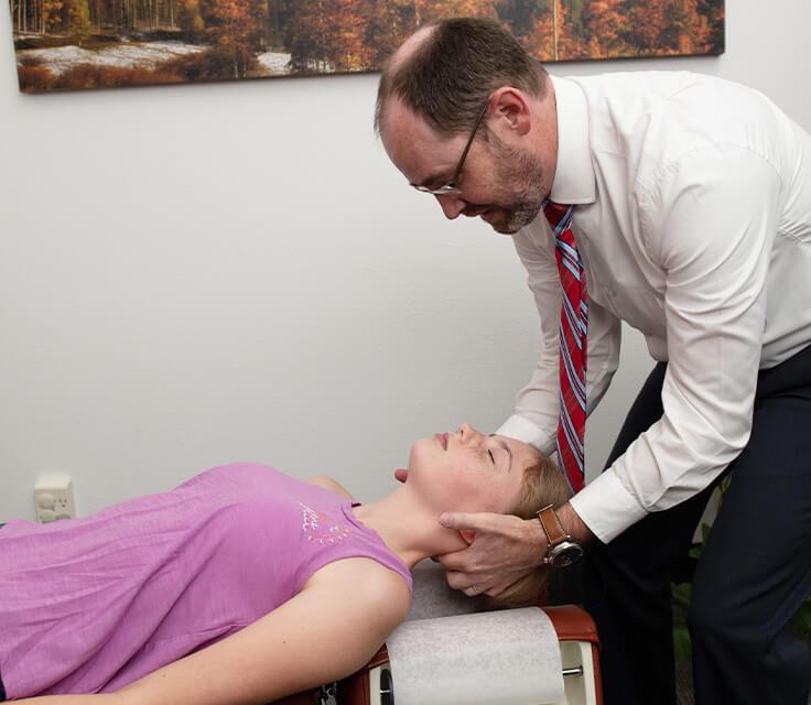 Dr. Mark Oberg adjusting neck