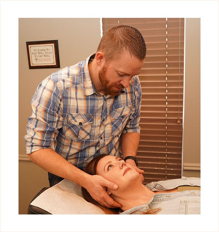 Doctor adjusting womans neck