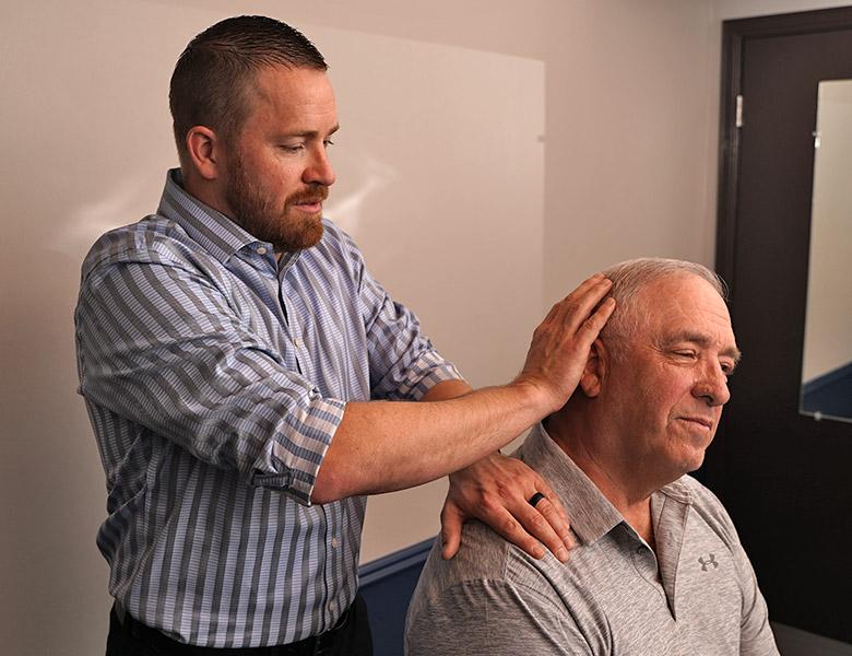Dr Jason adjusting mans neck