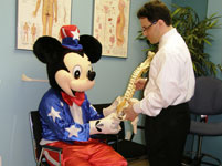 Dr. DeSano explaining about chiropractic