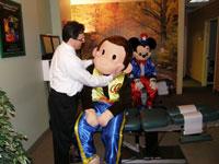 Dr. DeSano gently adjusting.