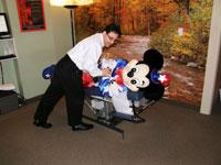 Dr. DeSano adjusting Mickey's lower back.