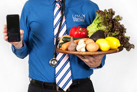 Dr LeMay holding veggie tray and phone