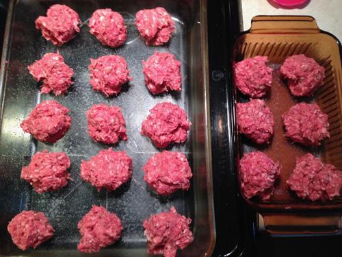 Uncooked meatballs on pan