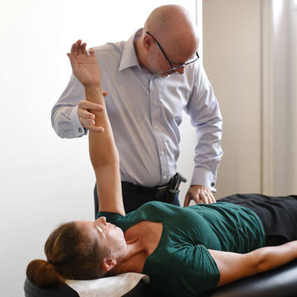 Dr. Sandy extending patients arm