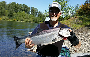 Dr. Acosta and a fish he caught