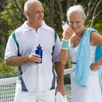 senior-couple-playing-tennis