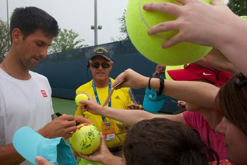 Novak Djokovic signing autographs