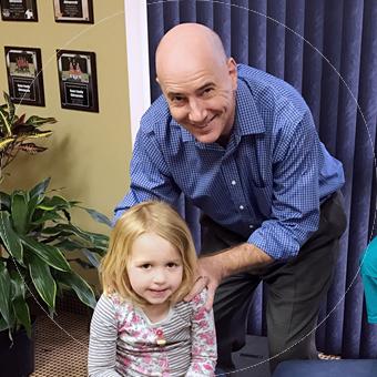 Chiropractor Fort Mill, Dr. Kane adjust child