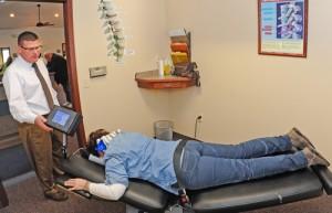 Dr. William Goss adjusting his patient