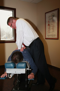 Dr. Goss giving a patient an adjustment