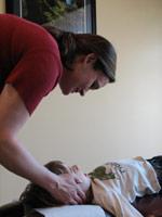 Dr. Osborn adjusting a patient.