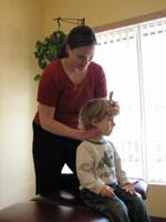 Dr. Osborn adjusting a cervical spine