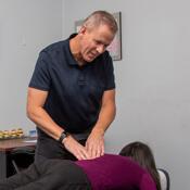 Dr Matthew Hoffmann adjusting patient